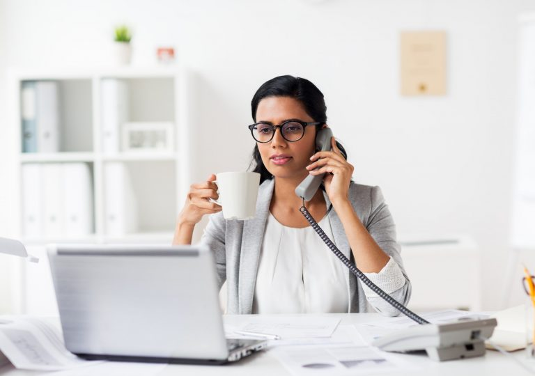 businesswoman calling on phone at office